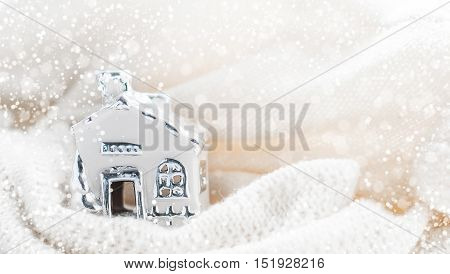 White fabulous home wrapped in white scarf.