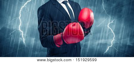 A dangerous sales person getting ready for a fight concept with red boxing gloves and thunder lightning in background.