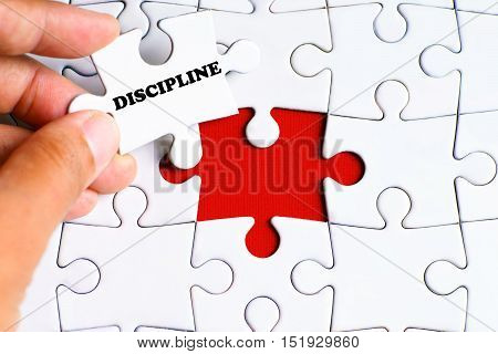 Missing puzzle with a hand hold a piece of