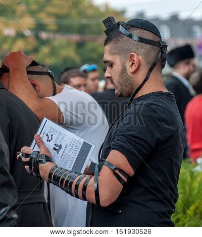 Jewish orthodox hasid wears tefillin and kippah. Uman, Ukraine - 2 October 2016.