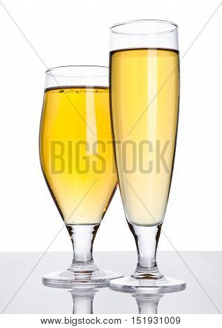 Glasses of beer cider with foam golden color on white background