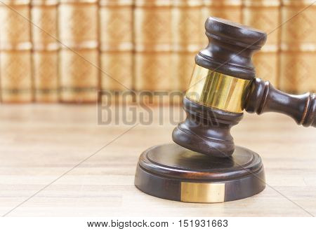 Wooden Law Gavel against a row of law books