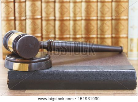 Wooden Law Gavel and a row of law books