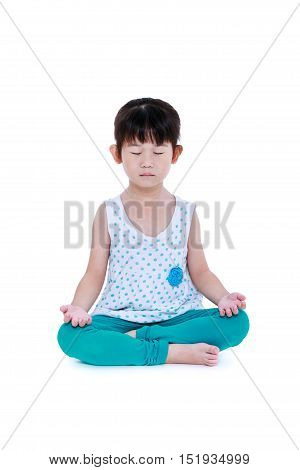 Asian pretty child with eyes closed and doing yoga exercises in lotus pose. Healthy girl practicing fitness at studio. Isolated on white background.
