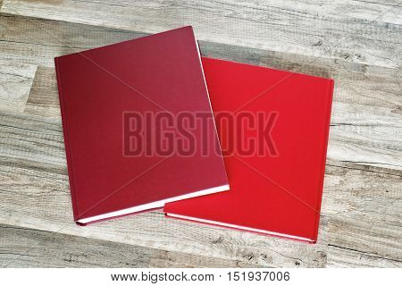 stack of red books on the floor