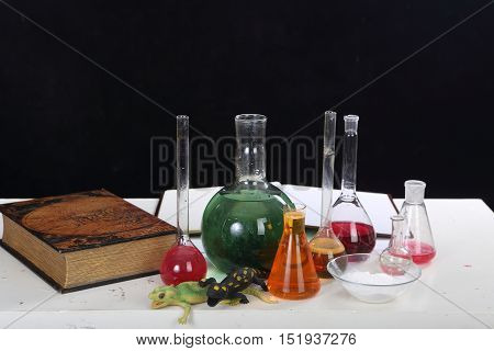 flasks with reagents for conducting chemical experiments on the table