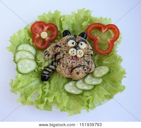 The cheerful tiger is made of rice. Ridiculous food for good mood and appetite