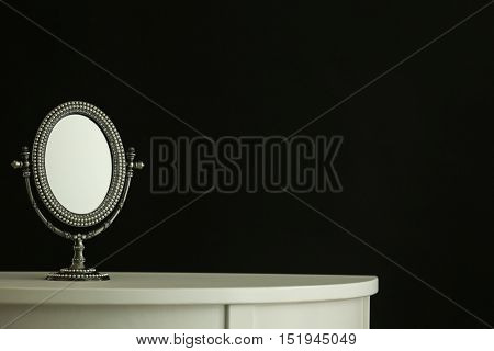 Female mirror on dark background