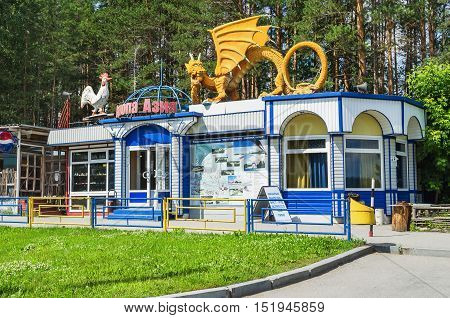 SVERDLOVSK OBLAST RUSSIA - JULY 16 2014: Café Europe - Asia on the border of Europe and Asia on a Sunny summer day