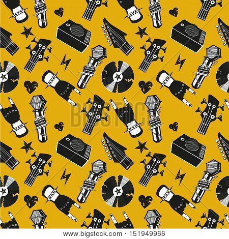 Texture with music equipment. Seamless pattern with microphone and guitar.