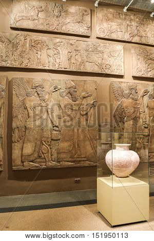 Moscow, Russia - October 04, 2016 - Part of the Egyptian room with a vase and murals with human figures. Pushkin state museum of fine arts.
