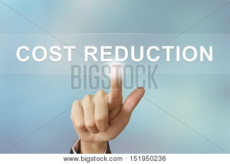 business hand pushing cost reduction button on blurred background
