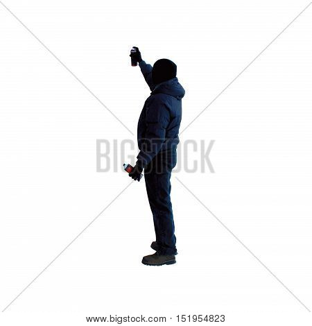 Artist with can of spray paint draws graffiti picture isolated on white background in black hood unknown back view