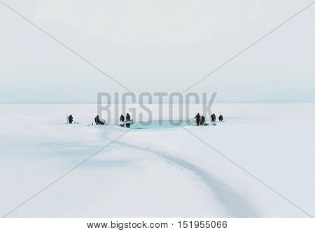 Many Fishermen Sit On The Ice And Fishing In Winter Cold Day