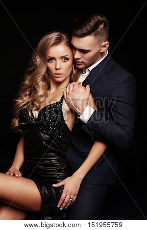 Gorgeous Woman With Blond Hair And Handsome Man In Elegant Clothes