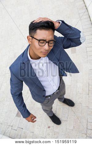 Asian Businessman With Headache