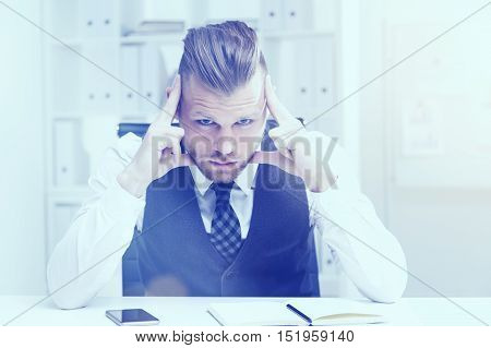 Thoughtful businessman is looking at camera with tension and considering his options. Concept of decision making. Toned image