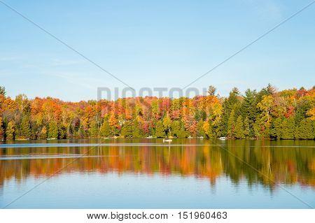 Autumn colors in Quebec Canada (Lac Saint-Amour in Sainte-Anne-des-Lacs)