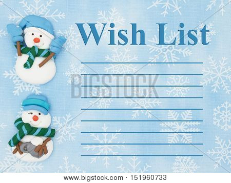 Christmas wish list Snowmen with a blue and white snowflakes background with text Wish List
