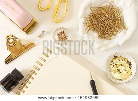 Over head flat lay pink and gold desktop