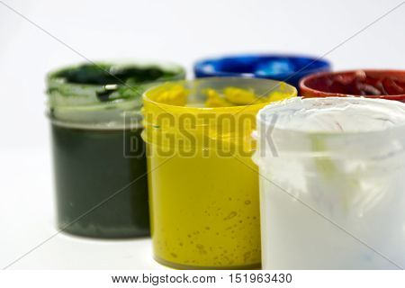 red yellow blue green white gouache in open jars drawing paint painting creativity