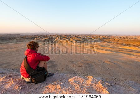 Tourist watching the stunning view of barren valley known as