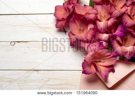 Colorful flowers in envelope flower delivery concept. congratulate