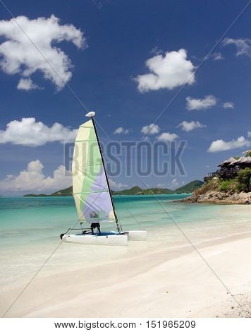 Catamaran With Colorful Sails Departs From Cocobay