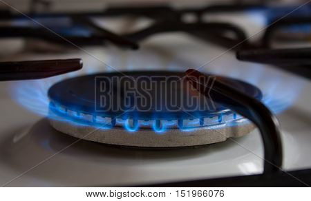 gas stove. burner with a blue flame