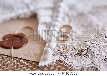 Wedding background with golden rings and veil.