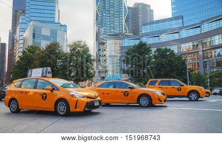 NEW YORK CITY - SEPTEMBER 05: Yellow cabs in the morning on October 5 2015 in New York City. It's the most populous city in the US and the center of the New York metropolitan area.