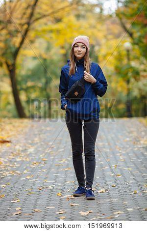 Stylish Sporty Brunette Woman Stylish Sporty Brunette Woman Hands In Pockets In Trendy Urban Outwear