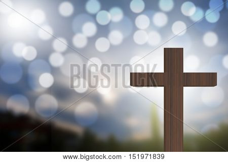 3D Rendering Of Wooden Cross On A Blue Sky With Bokeh