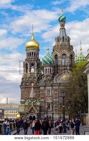 SAINT PETERSBURG RUSSIA - MAI 10 2014: walking people in front of church the Savior on Spilled Blood. Spas-na-krovi cathedral The cathedral Has rescued - on - blood