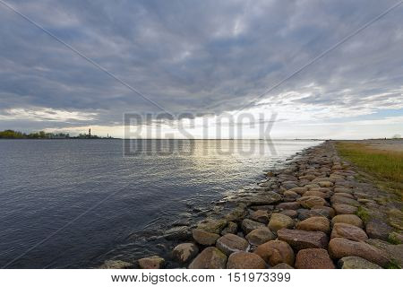 coast of the gulf paved red granite at sunset