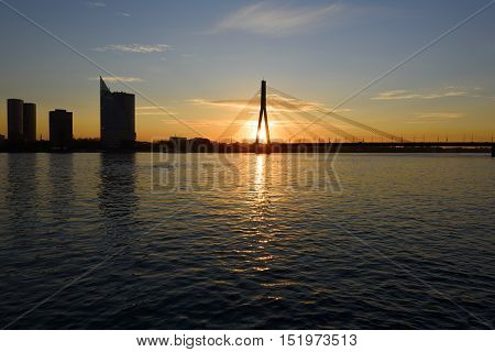 Sunset on the town river with bridge in Riga Latvia