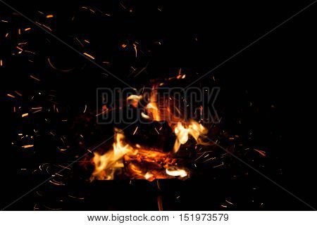 fire with sparks on a black background. The concept of nature.