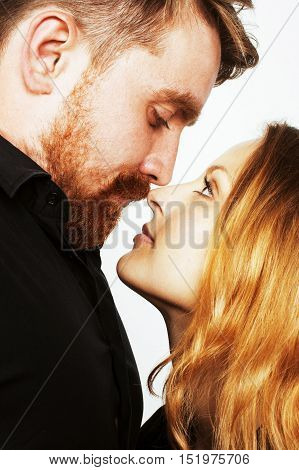 young tender couple, man and woman in love isolated on white, fooling around real modern hipster marriage close up