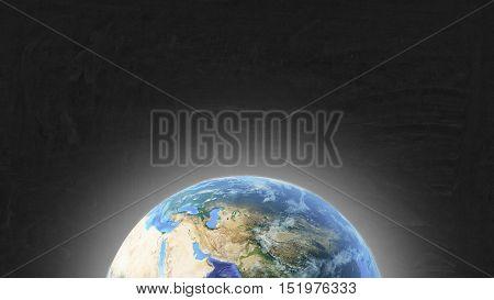 Planet Earth on the black chalkboard. Mock up.