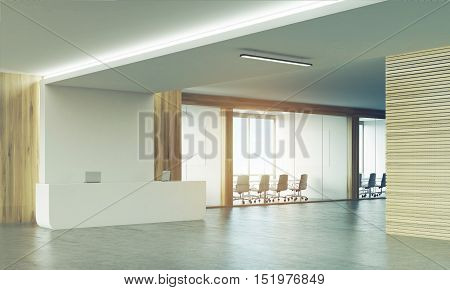 Side View Of Two Meeting Rooms And Sunlit Reception Desk