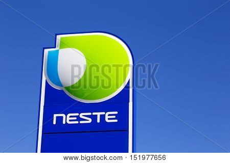 Tornio, Finland - July 20, 2016: Close-up of the brand sign at a Finnish Neste service station against blue sky.