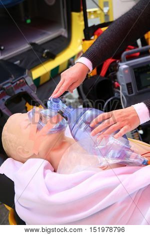 Details of practicing to use an oxygen mask on training doll