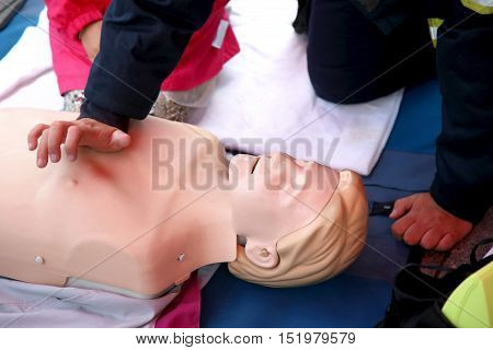 Details of practicing CPR chest compressioon on a dummy