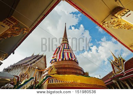 Wat That at bueng kaen nakhon lake khon kaen ThailandThailand Bhudda temple golden Stupa Khonkaen landmarkTemple in Khon Kaen Thailand; Wat That (Temple)