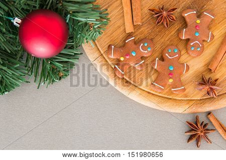 Many gingerbread men on a wooden board for Christmas