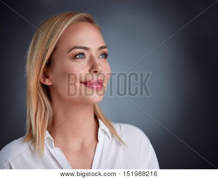 Very beautiful mid adult woman having moment for dreaming