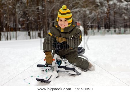 The Boy On Sledge