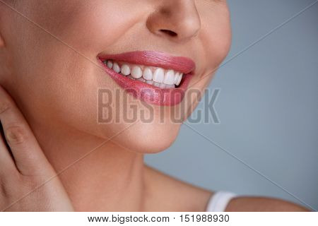 Laughing woman mouth with great teeth over white background