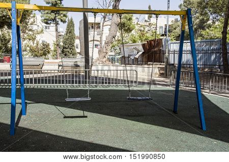 Alone teeter in child playgroundnostalgia regret emotions