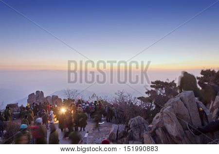 October 14, 2014.  Mount Tai, China.  Crowds of people watching the sunrise on Mount Tai in Shandong province in the winter in China.